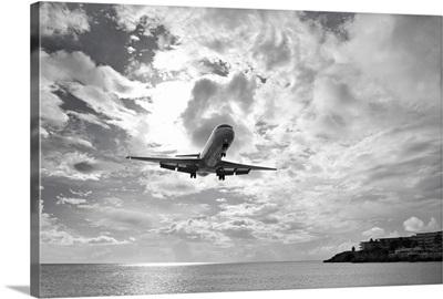 An airliner comes in for a landing in St Maarten, Netherlands Antilles.