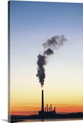 An oil refinery emits a plume of smoke, Minnesota