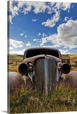 An old abandoned car rusts away in the ghost town of Bodie, CA.