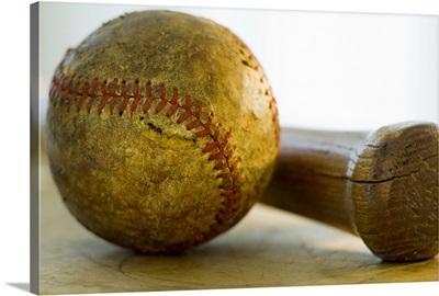 Antique baseball with baseball bat
