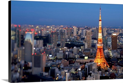 Arial view of Tokyo at dusk sign on illuminated Tokyo Tower.