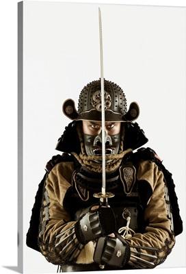 Asian man wearing samurai armor