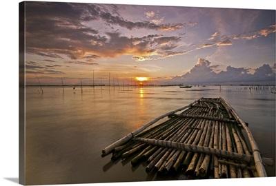 Bamboo raft at sunset.