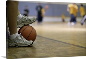 Basketball Player Holding Ball With Feet Wall Art Canvas