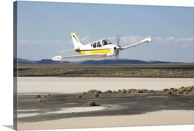 Beechcraft B33 flying low