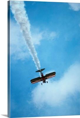 Biplane flying in blue sky