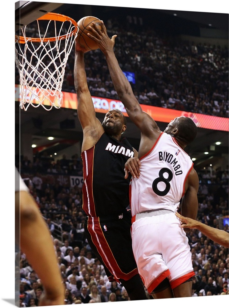 8cef7a6c4 Bismack Biyombo of the Toronto Raptors blocks a shot by Dwyane Wade of the Miami  Heat Wall Art