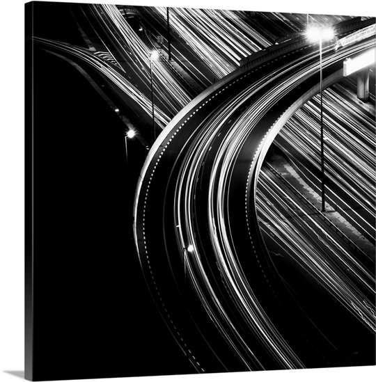 Black and white shot of multiple light trails of an overpass in dubai city