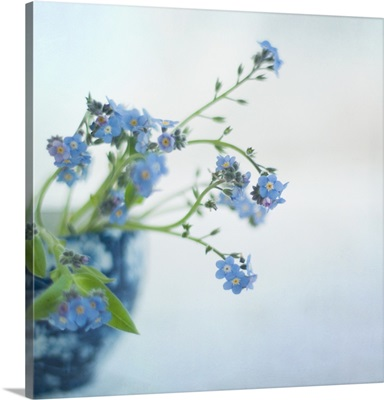 Blue flowers in blue textured vase.
