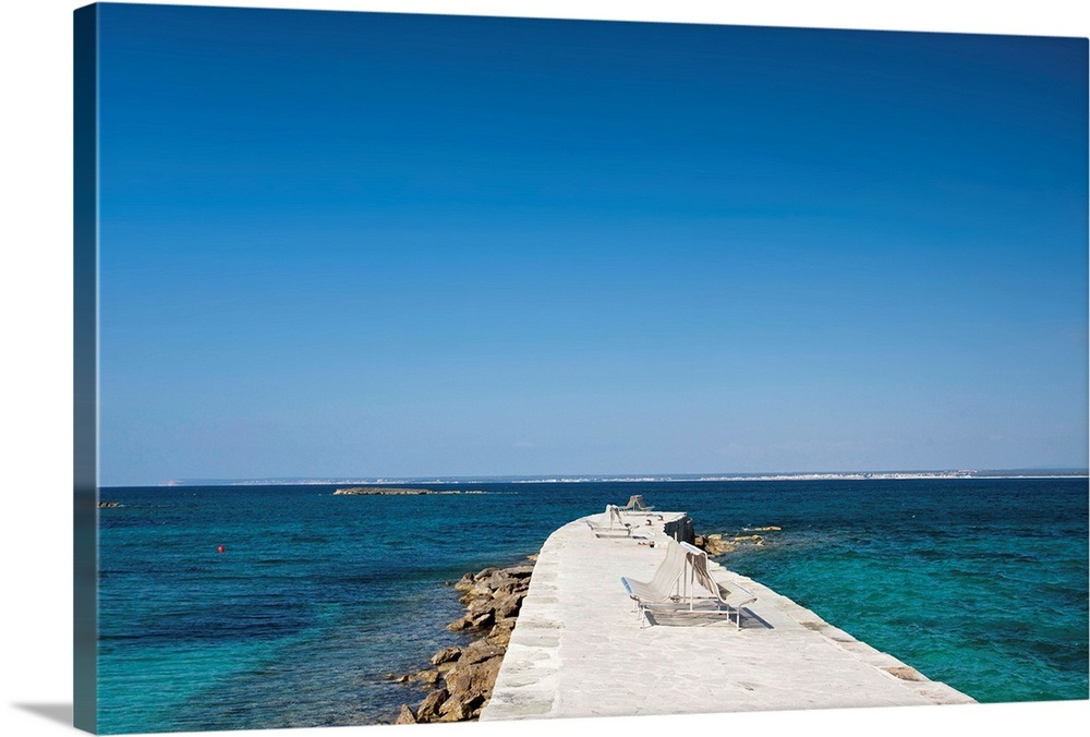 Blue mediterranean Beach of Es Trenc with pier and sitting bench