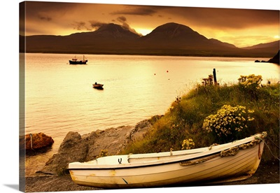 Boat on the shore at sunset, Island of Islay, Scotland
