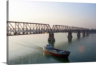 Boat passing from under bridge in river at Narshingdi, Bangladesh.