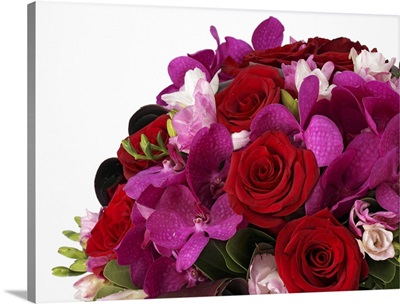 Bouquet of red roses, pink freesias, purple vanda orchids