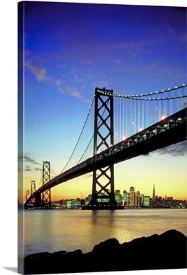 Bridge and city at sunset