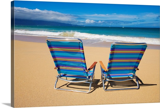 Brightly Colored Beach Chairs On The Sand Near Ocean
