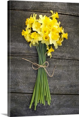 Bunch of daffodils on a wooden table