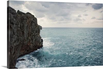 Cliff line and blue wild stormy Mediterranean sea, Mallorca.