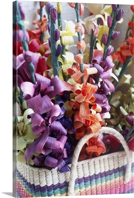 Close-up of a flower arrangement in a basket.
