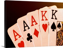 Close-up of a hand of aces
