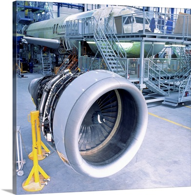 close-up of an aircrafts engine turbine kept in a hanger for assembly