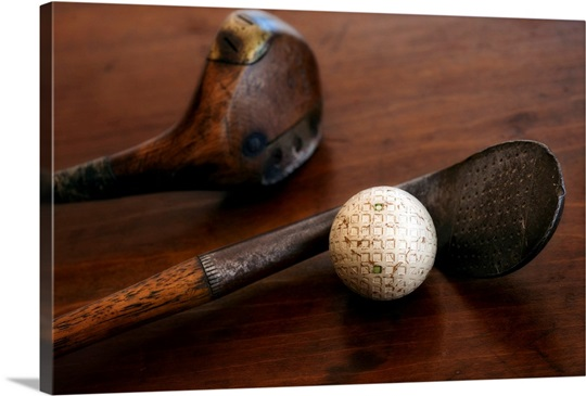 Close up of antique golf clubs and golf ball