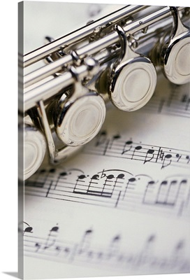 Close up of flute on sheet music