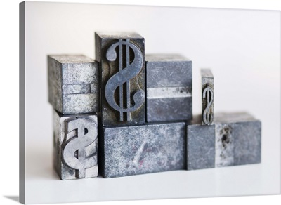 Close up of printing blocks with dollar sign