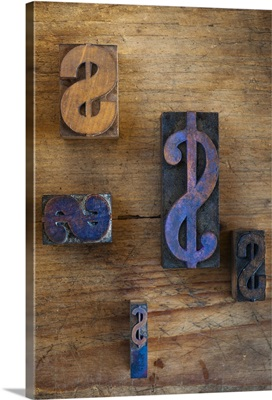 Close up of printing blocks with dollar sign on wood