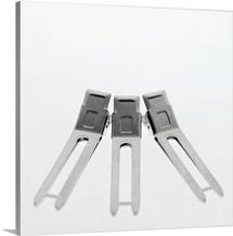 Close-up of three hair clips
