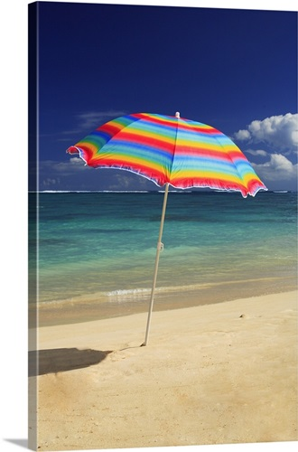 Colorful Beach Umbrella On The Sline Of A Tropical Canvas