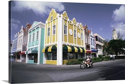 Colorful buildings and motorcycle, Oranjestad, Aruba