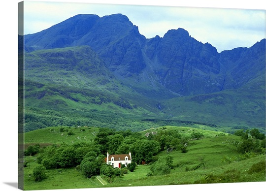 Cottage On Isle Of Skye At Foot Of Mountains, Highland, Scotland.