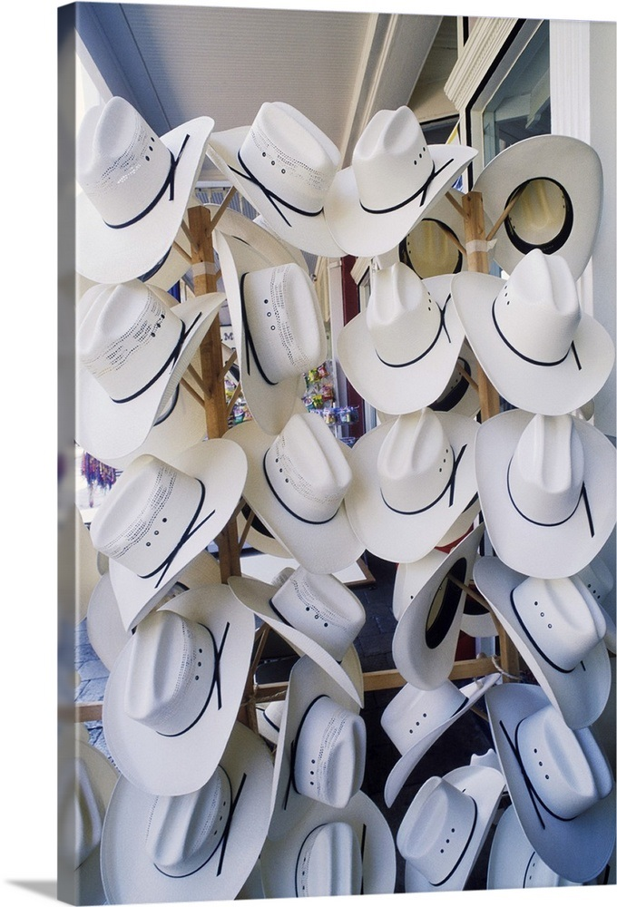 Cowboy hats hanging in a hat shop eee78552bf0