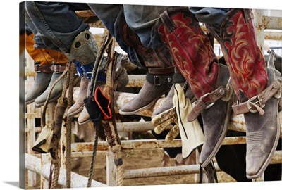 Cowboys sitting on a cattle stall