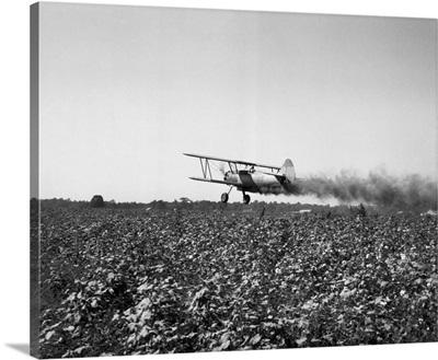 Crop Dusting Plane Flies Over Field