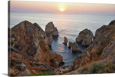 Da Piedade Pontdaawesome rocky cliff formations along ocean in Lagos, Argarve, Portugal.