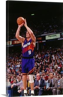 Dan Majerle 9 of the Phoenix Suns shoots against the Sacramento Kings