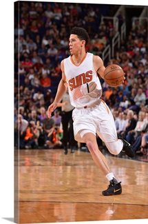 Devin Booker 1 of the Phoenix Suns drives to the basket