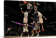 Devin Booker of the Phoenix Suns shoots the ball against the Denver Nuggets
