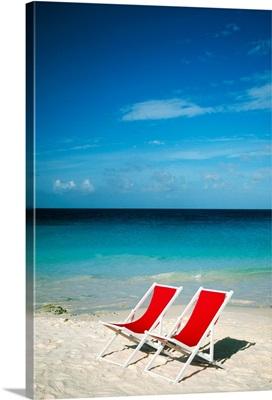 Empty beach chairs, Cancun, Mexico