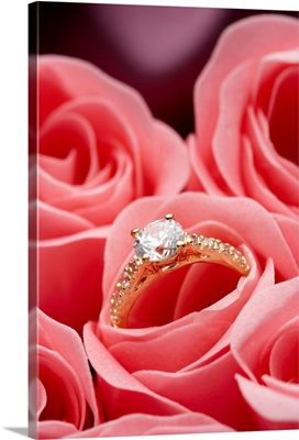 Engagement ring tucked in rosebud