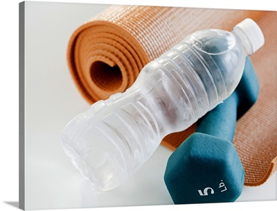Exercise mat, water bottle and weights, studio shot