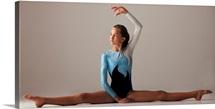 Female gymnast performing splits