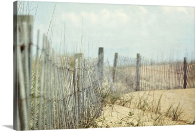 Fence on sand dunes at beach.