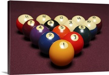 Fifteen billiard balls arranged in triangle on pool table