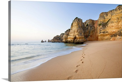 Footsteps in sand beach.