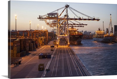 Freight cranes and container ships in port