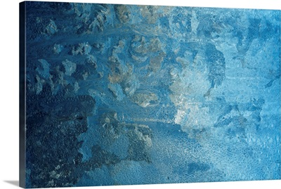 Frost making patterns on window pane