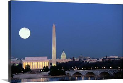 Full moon over Lincoln Memorial, Washington Monument and US Capitol Building