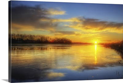 Golden sun reflection on lake in France.